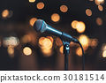Microphone on stage against a background concert 30181514