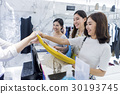 A young girl seems very happy when purchasing an item with her friends 30193745