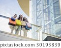 a group of women are standing in the glass balcony. 30193839