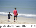 father and son walking and holding hands 30200319