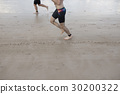 Runner is running on the beach. 30200322