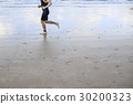 Runner is running on the beach. 30200323