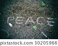 Inscription on asphalt with white chalk: peace 30205966