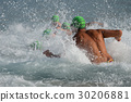 Man running in water in the swimming competition 30206881