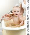 Portrait of baby boy playing in foam at bathroom 30207956