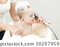 Baby boy having bath and playing with shower head 30207959