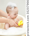 Baby playing in foam bath with yellow rubber duck 30207966