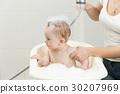 Cute baby boy sitting in bath full of foam 30207969