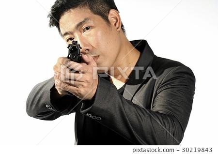 Man aiming gun. 30219843