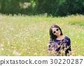 Woman in flower field. 30220287
