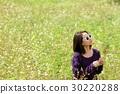 Woman in flower field. 30220288