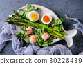 Cooked green asparagus with egg 30228439