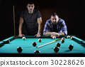 hansome man playing billiards alone 30228626