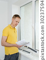 Man with window blind. 30237594