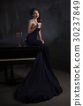 beautiful young woman in black dress  30237849