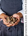 chef handing shiitake 30244430