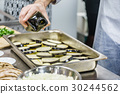 chef making moussaka 30244562