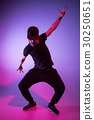 The silhouette of one hip hop male break dancer 30250651