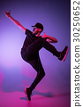 The silhouette of one hip hop male break dancer 30250652