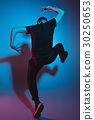 The silhouette of one hip hop male break dancer 30250653