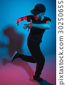The silhouette of one hip hop male break dancer 30250655