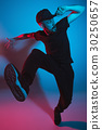 The silhouette of one hip hop male break dancer 30250657