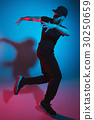 The silhouette of one hip hop male break dancer 30250659