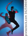 The silhouette of one hip hop male break dancer 30250669