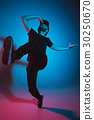 The silhouette of one hip hop male break dancer 30250670