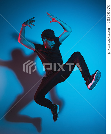 The silhouette of one hip hop male break dancer 30250676