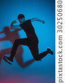 The silhouette of one hip hop male break dancer 30250680