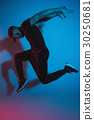 The silhouette of one hip hop male break dancer 30250681