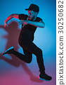 The silhouette of one hip hop male break dancer 30250682