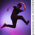The silhouette of one hip hop male break dancer 30250684