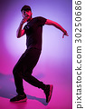 The silhouette of one hip hop male break dancer 30250686