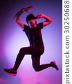 The silhouette of one hip hop male break dancer 30250688