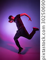 The silhouette of one hip hop male break dancer 30250690