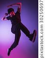 The silhouette of one hip hop male break dancer 30250697