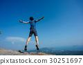 jumping on rocky mountain peak  30251697