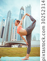 Young girl doing yoga against skyscrapers 30252314