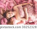 Pregnant pretty woman is wearing fashion dress 30252328