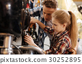 Cute girl and her dad fixing bike together 30252895
