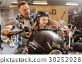 Cute dreamy family sitting on the motorbike 30252928