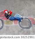 Little boy having fun with race car drawing with 30252961