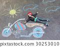 Little kid boy in helmet with motorcycle chalk 30253010