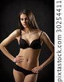 beautiful sexy brunette woman posing in black 30254411