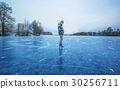 crystal clear frozen lake and smyling man in ice s 30256711