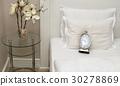 Alarm Clock on Pillows 30278869