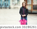 Beautiful young pre-teen girl with pink umbrella. 30286261