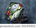 Fresh uncooked Dorado fish or sea bream 30295602